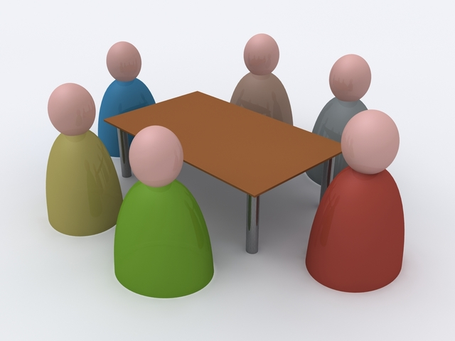 Illustration av sex figurer runt ett bord
